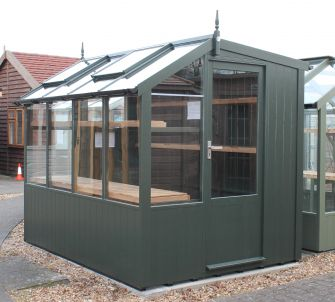 Jay 6ft 8in x 8ft 4in (2.03m x 2.55m) in optional painted finish, with guttering and high level shelf